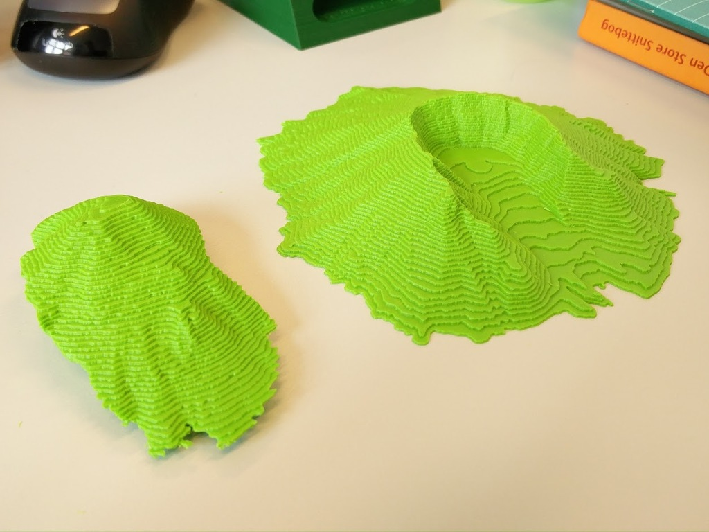Separated parts of 3D printed model of Mount Saint Helens pre and post eruption